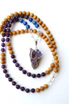 Intuitive Mala.  Holistic Rain hand made crystal and gemstone mala beads.  Amethyst, Lapis Lazuli, Quartz, Sandalwood mala.