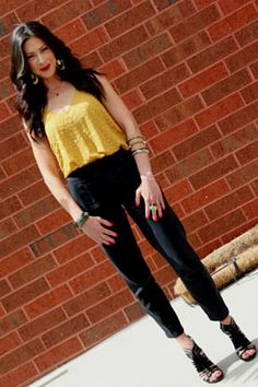 -Yellow studded tank by Jamison at Saks Fifth Avenue  -Black pants by Trina Turk  -Black tie-up shoes by Dolce Vita