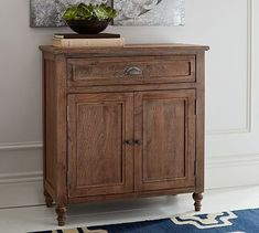 This petite cabinet fits global style into a compact footprint. Molding details, turned feet and a fluted drawer pull add a romantic touch. A light finish highlights the natural beauty of the mango wood's grain and hue, which vary slightl Entryway Furniture, Entryway Decor, Kitchen Furniture, Space Furniture, Bar Furniture, Cheap Furniture, Entryway Console, Entryway Ideas, Classic Furniture
