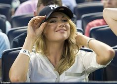 Hats off! The Vogue cover girl proved to be the all-American girl in a baseball cap at the Yankees game