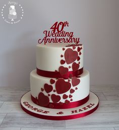40th (Ruby) Wedding Anniversary cake. White with ruby red cascading hearts