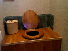 Composting Toilet by AlaskanEcoEscape, via Flickr. Another idea: covered pottery for the petemoss.