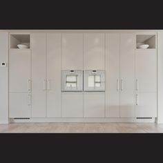 The kitchen's two integrated refridgerator-freezers are positioned one at each…
