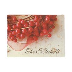 Red berries on old script holiday doormat