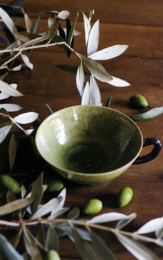 Green glazed terracotta cup.......love the olive branch and olives....