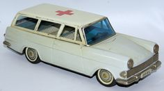 RARE Vintage 1950's Tin Lithographed Friction Powered OPEL REKORD AMBULANCE Station Wagon by Bandai, Japan. Made for the German market. Nice detailed interior. Friction is in working order. Ambulance