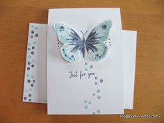 Stampin Up Watercolor Wings and Bold Butterfly thinlets. Soft Sky, Pool Party and Night of Navy Ink overlaid with a wax paper butterfly die cut using the Butterfly Basics thinlets