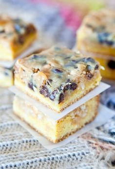 Coconut Peanut Butter Magic Cake Bars - Soft yellow cake topped with butterscotch & chocolate chips, coconut, and drenched in a creamy, sweetened condensed milk-peanut butter bath! Easy recipe that's a hit with crowds at averiecooks.com