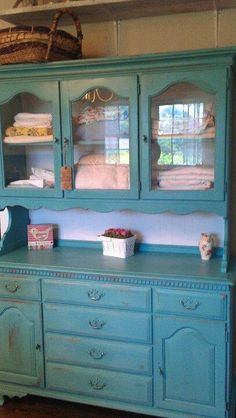 Vintage Aqua Milk Painted Hutch for glassware and extra linens. Aqua as standout pc or in cream