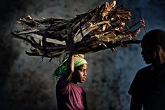 My burden The reality of life on a street in Harar, Eastern Ethiopia. Children work to support their families and contribute to survival. Cool Photos, My Photos, Wood Fuel, African Children, Reality Of Life, Photo Competition, Working With Children, National Geographic Photos, Daily Photo
