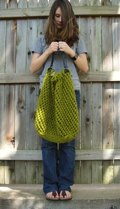 The Weekender bag knitting pattern.Uses 2 skeins of Lion Brand wool ease thick and quick. Color shown is Citron.