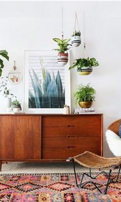 Love the plant pots (both hanging and grounded pots) and the idea of a large framed nature print (not keen on that particular print itself, but another one of my choice and liking).  From Anthropologie.