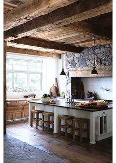 Kitchen design - Home and Garden Design Ideas.  Use to have the rugged look the beams are great.