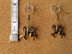 Golden Pegasus earrings by FabboDesigns on Etsy