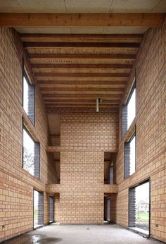 Protruding brickwork gives a ribbed facade to this family house near Brussels.