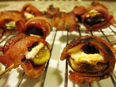 Stuff figs with goat cheese, add a pecan (or almond), wrap in bacon, and secure it with a toothpick. Bake @400 degrees F for about 20 minutes. Alternately, you can broil them for about 5 minutes or until bacon is cooked.