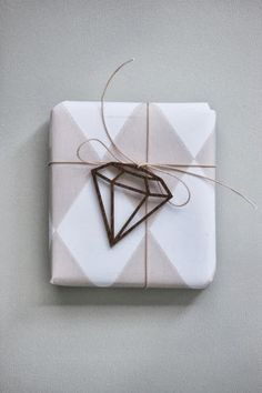 DIY Diamond Gift Topper- Add a simple trinket to a wrapped gift as an embellishment. Personalize it by making it something that relates to the gift recipient.