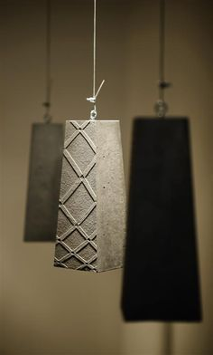 I love the surface design on these concrete pendants | lighting | interior design