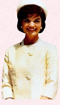 First Lady Jackie Kennedy displays her trademark chic - pillbox hat, pearls, and stylish suit. formal, for day: the pillbox hat, pearls, the three-quarter length sleeves, Her signature look: the boxy Chanel suit jacket with A-line skirt