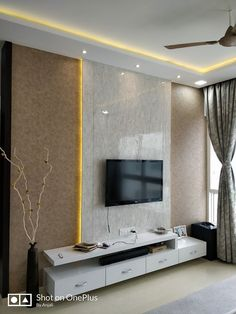 Acrylic Finish T. Unit highlighted with Cove Lighting & Textured Backwall- GharPedia House Ceiling Design, Ceiling Design Living Room, Room Door Design, Tv Wall Design, Home Room Design, Pop Design For Hall, Modern Tv Unit Designs, Living Room Tv Unit Designs, Tv Unit For Living Room