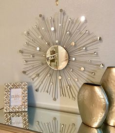 Add an elegant touch to your home with this gorgeous, hand-crafted sunburst mirror. The center mirror is 8 inches in diameter, and surrounded by silver wooden rods, with mini mirrors and diamond gems perfectly placed throughout. The overall size of this wall art mirror is approximately 30 inches in diameter.