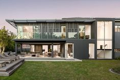 Contemporary two-story house located in Cape Town, South Africa, designed by Renato Graca. Two Story Homes, Front Elevation, Story House, South Africa, Contemporary, Mansions, Architecture, House Styles, Design