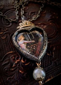 The Angel & the Peacock ~  by Renaissance Artist Benozzo Gozzoli    Found image under a glowing crystal glass heart cabochon. Set within a hand