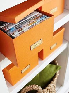 Put Unsightly DVDs in Photo Boxes from Michaels' or other craft stores. Use colors or patterns to match your decor...