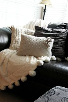 Learn how to sew these gorgeous sweater pillows. Also THAT BLANKET WITH THE FLUFFY BALLS!!! love it.