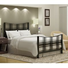 Add a stylish touch to your bedroom with this queen-size 'Stanford' bed. A textured black finish and an embellished head and footboard highlight this bed.