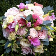 A pink freesia and rose bouquet from Amanda Austin Flowers of England.