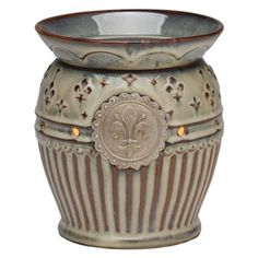 Charlemagne Full-Size Scentsy Warmer PREMIUM    Adorned with a silver fleur-de-lis medallion, Charlemagne glows in cream flecks of blue over a brown base coat. Embossed fleur-de-lis designs are repeated on the base and complemented by the embossed scallop design on the dish. High-gloss reactive-glaze finish.