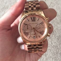 Rose gold Michael Kors Lexington watch 100% authentic. Great condition. Beautiful watch. Comes with box and I believe the receipt is even in there too. Michael Kors Accessories Watches