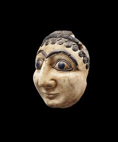 COMPOSITE HEAD OF A WORSHIPER OR DEITY  Sumerian, 2550-2250 BC Alabaster, lapis lazuli, and brown limestone