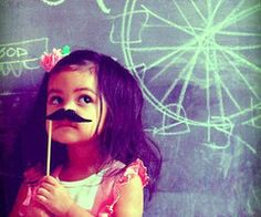 little girl with mustache