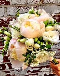 Bridal Bouquet: blush peonies, white lisianthus, double cream freesia, and spiraea. Courtesy of Midge Flower Boutique: www.midge.ca