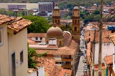 San Gil, Colombia: Looking downhill at narrow street; colonial architecture stock photo