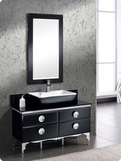 """Fresca Moselle 47"""" Modern Glass Bathroom Vanity with Mirror is the epitome of luxury. This high quality Fresca vanity has a steel frame construction with a tempered glass exterior. The interior drawers are made from Macasser Ebony which gives it a classic, high end look. Many faucet styles to choose from.  Spectacular designs are available in Fresca Modern vanities collection, http://www.listvanities.com/modern-bathroom-vanities.html with choices between glasses or marble top wall mounted va..."""