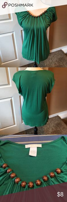 "Green Top Really pretty Kelly green top with wood beads.  Pleated front and with cap sleeves.  Good preloved condition with normal wash and wear.  Measurements laying flat; underarm to underarm is 18"" and underarm to hem is 17 1/2"".  Light piling directly underarm as shown in last picture.  Truly a pretty top with life still in it!  Bundle and save $$$. Design History Tops"