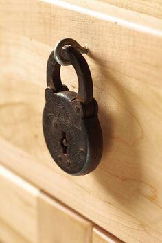 Iron padlock instead of a drawer pull.  Awesome idea.  Have a collection of these. humm.....