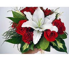 Red roses and a large white lily for a bridal bouquet - $169.95