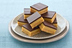 Another NESTLÉ Sweetened Condensed Milk recipe from our 100 years of Sweet Baking Memories Book. This truly is the Best-Ever Caramel Slice - the thick layer of delicious caramel is sandwiched between a coconut biscuit base and lush, mouthwatering dark ch. Köstliche Desserts, Delicious Desserts, Yummy Food, Passover Desserts, Plated Desserts, Baking Recipes, Cake Recipes, Dessert Recipes, Bake Sale Recipes