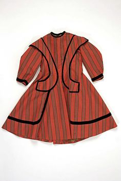 Child's striped red wool dress with black velvet trim (front), American, 1866.