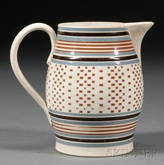 Engine-turned Mochaware Jug, Britain, c. 1800, baluster-form pearlware jug banded with blue, black, and rust