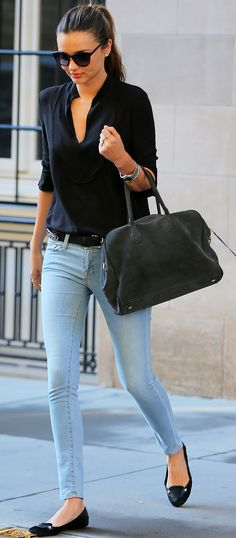 Spring / Summer - street style - simple look - light denim skinnies black v neck blouse black flats black belt