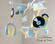 """hehehe Baby Crib Mobile - Baby Mobile - Music Band Mobile - """"Rock Star Mobile"""" Instruments, Cassette, Music Notes (You can pick your colors). $90.00, via Etsy."""