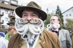 Man with curly white beard at the World Beard and Moustache Championships.