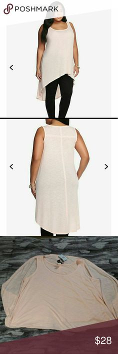 Torrid Hi-lo Tank Torrid Plus size 2.  It's time to go to the extremes. A long cut gives this hi-lo tank a fashion-forward vibe. It's a soft, light pink, semi-sheer style and has a trendy casual look that's ready to go the extra mile. torrid Tops Tank Tops