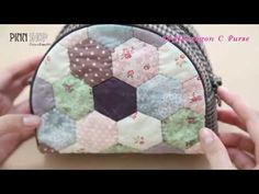 "REALLY CUTE make up bag! video tutorial - quilted zippered bag, with patched ""hexi"" front, and piping around edges."
