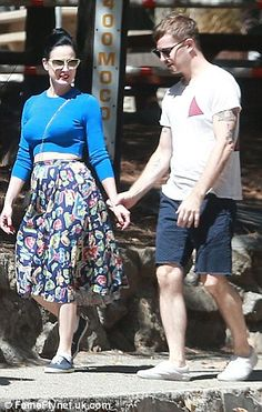 Tender lovin': The burlesque dancer and her man opted for casual clothing during the outing where they were seen hugging and holding hands